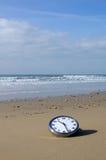 Clock on a beach Royalty Free Stock Photo