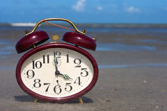 Clock on a beach Stock Image