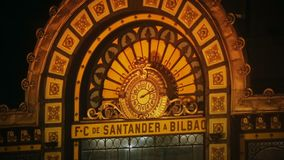 Clock on beautiful facade of Santander train station in Bilbao, travel to Spain. Stock footage stock video footage