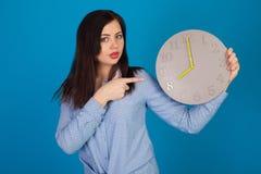 Clock and beautiful woman Stock Photos