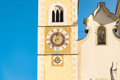Clock of the bell tower of the cathedral of Innichen, Italy. Royalty Free Stock Photo