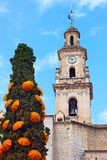 Clock and Bells Tower with umbrellas decorated cypress tree Royalty Free Stock Photos