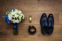 Clock, belt, wedding bouquet and shoes. Men`s fashion Royalty Free Stock Photography