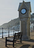 Clock and bench. Clock tower and bench on sea front Stock Images