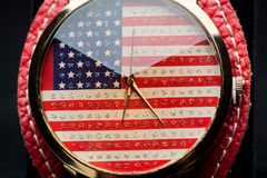 Clock on a black background. American Flag Stock Photography
