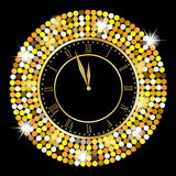 Clock on a black background with gold spangles Stock Images