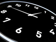 Clock in black background and white dials Stock Image