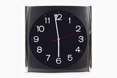 Clock black-grey stainless on the wall and table isolated on whi. Te background Stock Photography
