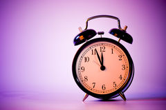 Clock. Black old style alarm clock with copy space Royalty Free Stock Photos