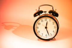 Clock. Black old style alarm clock with copy space Stock Image
