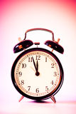 Clock. Black old style alarm clock with copy space Royalty Free Stock Photography