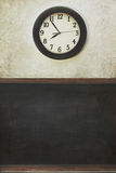 Clock and blackboard with distressed wall Stock Photos