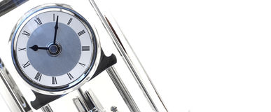 Clock on Blank. Shot of clock against white Royalty Free Stock Photography