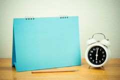 Clock and blank paper with pencil Royalty Free Stock Photography