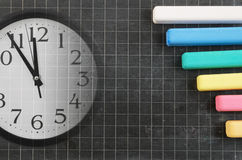 Clock and blank school board Royalty Free Stock Image