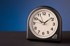 Clock on blue background. Old clock on blue background Royalty Free Stock Photos