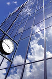 Clock on the blue office building background Royalty Free Stock Photography