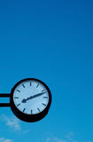 Clock on blue sky background. Wall clock on blue sky background Stock Photos