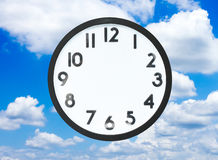 Clock and sky Stock Photography