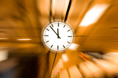 Clock blurred ,conceptual image of time running or passing away effect  zoom out. Alarm clock to movements Royalty Free Stock Photos