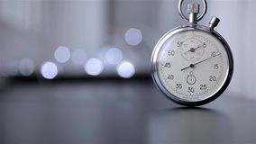 Clock on a blurry background with bokeh stock video footage