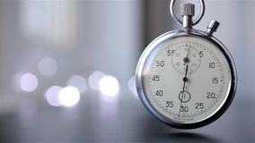 Clock on a blurry background with bokeh stock footage