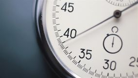 Clock on a blurry background stock footage