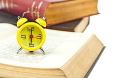 Clock and book as time management Stock Images