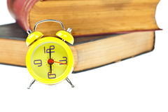 Clock and book as time management Stock Photos