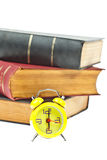 Clock and book as time management Stock Photo