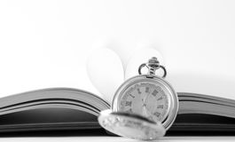 Clock and book Stock Photos