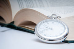 Clock and book Stock Images