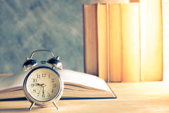 Clock and book Royalty Free Stock Image