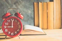 Clock and book Royalty Free Stock Photos