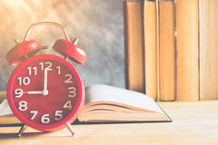Clock and book Royalty Free Stock Images