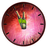 Clock with bottle of champagne waiting for midnight Stock Photo