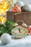 Christmas card with clock and Christmas decor. royalty free stock images