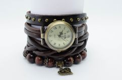 Clock with a bracelet of natural stones Royalty Free Stock Photography