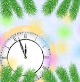 Clock and branches of tree on a christmas background Royalty Free Stock Photo