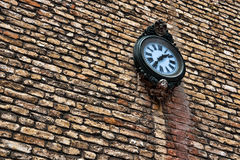 Clock on brick wall Stock Photos