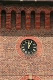 Clock on brick wall. Suburb The Rocks in Sydney Royalty Free Stock Photo