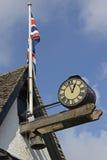Clock and British flag at Burford, England Stock Images