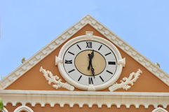 Clock on building wall Stock Image