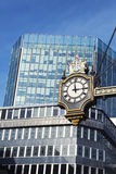 Clock and buildings Stock Photos