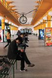 A clock in a bus station. People waiting and traveling transmitting ideas and cultures Stock Photo
