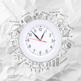 Clock with business sketches Stock Photo