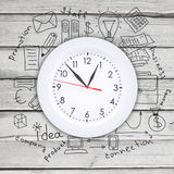 Clock with business sketches Royalty Free Stock Image