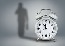 Clock with businessman shadow, time management concept Stock Photos