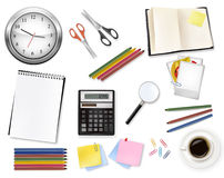 A clock, calculator and some office supplies. Royalty Free Stock Photo