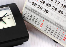 Clock on calendar sheets Royalty Free Stock Photo
